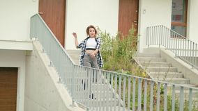 Young woman dancing on the stairs stock footage