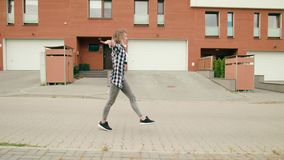 Young woman dancing in the street stock footage