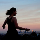 Young woman dancing in the sunset Royalty Free Stock Photography