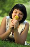 Young woman with dandelion Stock Photography