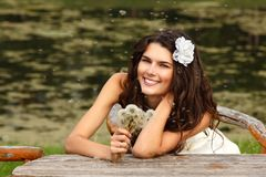 Young woman with dandelions summer outdoor, beautiful bride has Stock Photos