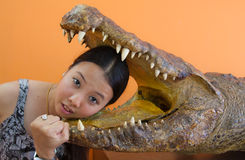 Young woman in danger with crocodile mouth. And expressions on her face Stock Image