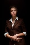 Young woman on a dark background. A young cute woman on a dark background royalty free stock images