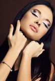 Young woman with dark  hair and bright extraordinary makeup Royalty Free Stock Images