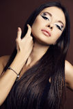 Young woman with dark  hair and bright extraordinary makeup Royalty Free Stock Photos