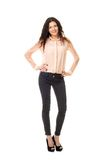 Young woman in dark jeans and light shirt Royalty Free Stock Photos