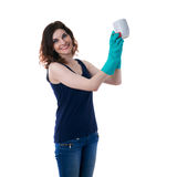 Young woman in dark T-shirt and green rubber gloves over white isolated background Stock Image
