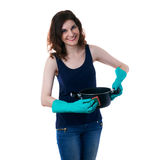 Young woman in dark T-shirt and green rubber gloves over white isolated background Royalty Free Stock Image