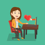 Young woman dating online using laptop. Stock Image