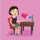 Young woman dating online using laptop. Royalty Free Stock Photos