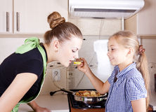 Young woman with a daughter. Young women with a daughter in the kitchen preparing Stock Images