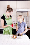 Young woman with a daughter. Young women with a daughter in the kitchen preparing Stock Photo