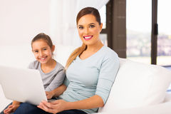 Young woman daughter laptop Stock Images