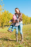 The young woman with the daughter on walk Stock Photography