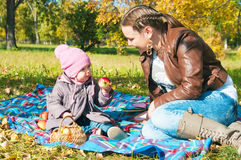 The young woman with the daughter on walk Stock Photos