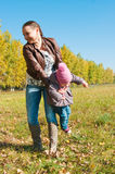 The young woman with the daughter on walk Royalty Free Stock Photo