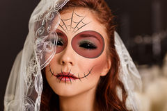 Young woman in day of the dead mask. Beautiful bride in day of the dead mask skull face art stock images