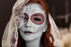 Young woman in day of the dead mask. Beautiful bride in day of the dead mask skull face art stock image