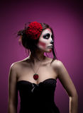 Young woman in day of the dead mask skull face art Royalty Free Stock Image