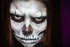Young woman in day of the dead mask skull face art. Halloween face art Royalty Free Stock Images
