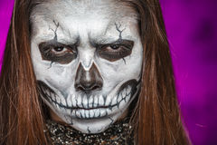Young woman in day of the dead mask skull face art. Halloween face art Royalty Free Stock Photo