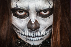 Young woman in day of the dead mask skull face art. Stock Photos