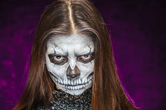 Young woman in day of the dead mask skull face art. Halloween face art Stock Photography