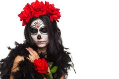Day of the dead. Halloween. Young woman in day of the dead mask skull face art and rose. Isolated on white. closeup. Young woman in day of the dead mask skull royalty free stock images
