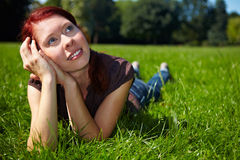 Young woman daydreaming in a park Royalty Free Stock Photography