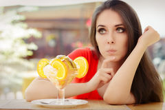 Young Woman Deciding to Eat a Summer Desert Royalty Free Stock Photography