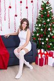 Young woman with decorated Christmas tree at home Royalty Free Stock Photography