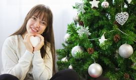 Decorating christmas tree. Young woman decorating christmas tree Stock Photography