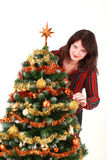 Young woman decorating christmas tree Royalty Free Stock Photos