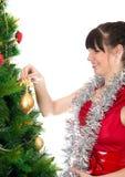 Young woman decorating christmas tree Stock Image