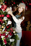 Young woman decorating Christmas tree Stock Image