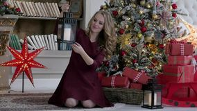 Young woman decorating a Christmas tree at home. Young woman decorating a Christmas tree stock video footage