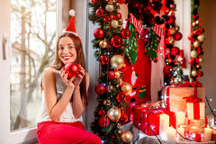 Young woman decorating Christmas tree Stock Photography