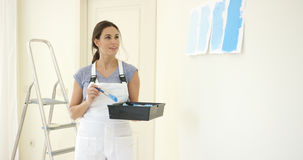 Young woman decorating her home Royalty Free Stock Photo