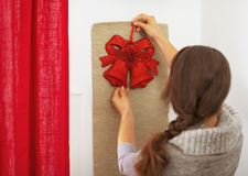 Young woman decorating home for christmas . rear view Stock Image