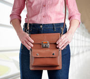 Young woman in deep blue jeans holding a bag Royalty Free Stock Photo