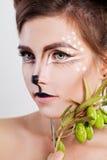 Young Woman Deer Animal. Face with Artistic Makeup Stock Photo