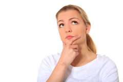 Young woman deliberates a decision Royalty Free Stock Photography