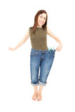 Young woman delighted with her dieting result Royalty Free Stock Photos