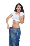 Young woman delighted with her dieting results Royalty Free Stock Image