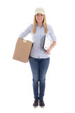 Young woman delivering package holding clipboard isolated on whi Stock Image