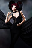 Young woman with demonic look. Young woman with demonic creative look Royalty Free Stock Photography