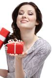 Young woman demonstrates a gift Stock Photos