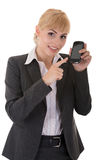 Young woman demonstrates a phone with touch screen Royalty Free Stock Images