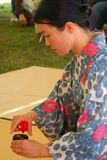 Traditional Japanese Tea Ceremony demonstration. A young woman demonstrates the traditional art of a Japanese tea ceremony stock photography