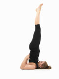 Young woman demonstrating difficult yoga pose Royalty Free Stock Images
